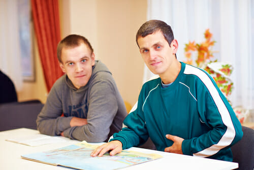Image of two men for our list of great autism resources for adults