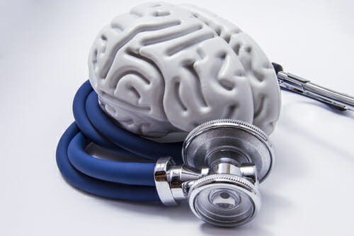 Image of a brain and stethoscope for our FAQ What are the Different Types of Behavioral Therapy?