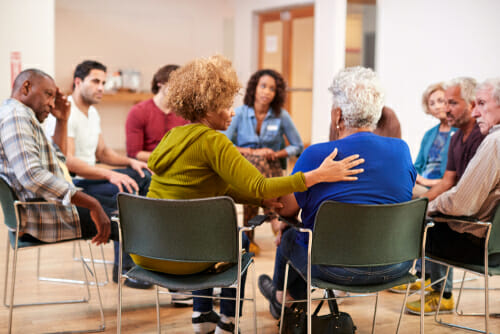 Image of support group for our FAQ What is a Community Mental Health Center?