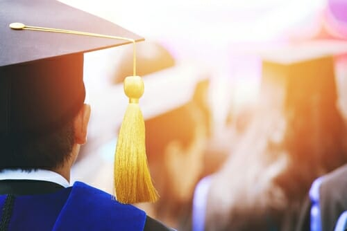 Image of a graduate for our FAQ about what degrees to pair with a BCBA