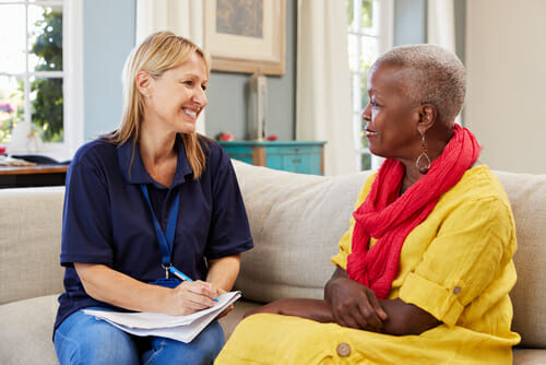 Image of a social worker and client for our FAQ on What is a Typical Day for a Social Worker?