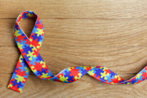 Image of puzzle ribbon for our ranking of best scholarships for students on the autism spectrum