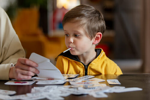 An image of a little boy and BCBA for our article on the job outlook for applied behavior analysis.